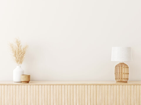 Interior wall mockup in minimalist Japandi style with light biege wooden console, dried pampas grass and wicker basket lamp on empty warm white background. Close up view, 3d rendering, 3d illustration