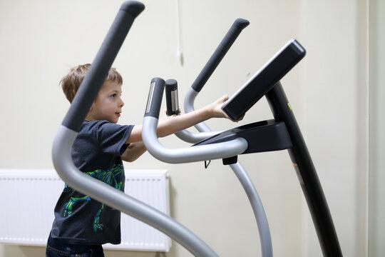Child exercising at stride treadmill