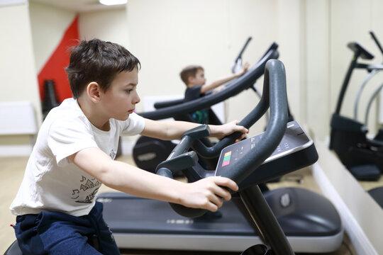 Child exercising on stationary bike