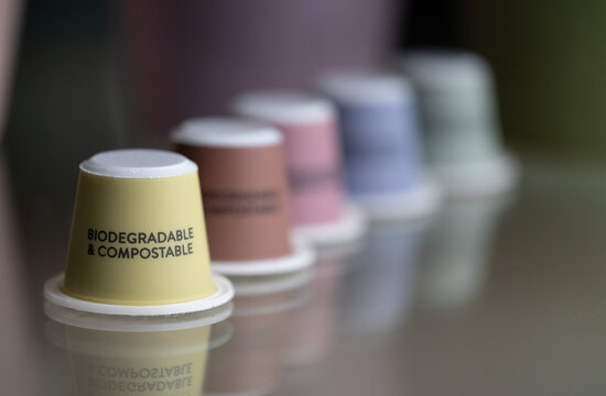 Close up of colourful, sustainable eco friendly coffee capsules. The pods are compostable and biodegradable.