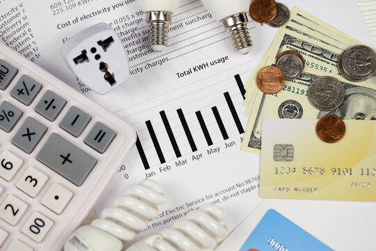 Abstract American electricity bill. Concept of saving money by using energy savings led light bulbs and electric bill payment