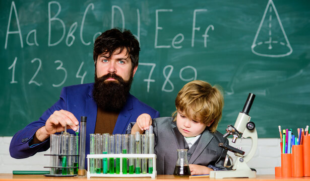 Little kid learning chemistry in school laboratory. father and son at school. school kid scientist studying science. Back to school. man with little boy. When in doubt, approximate successively