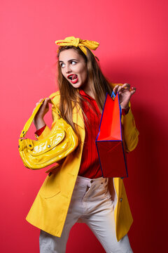 funny woman in yellow coat hold shopping bags, holidays