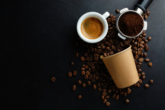 Coffee beans and espresso on dark background