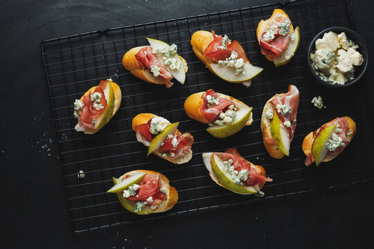 Small appetizers with prosciutto on board