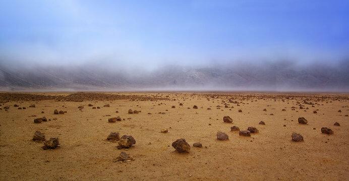Empty Barren Landscape of Planet Mars. Dry desert alien world with only rocks, soil and a blue sky.