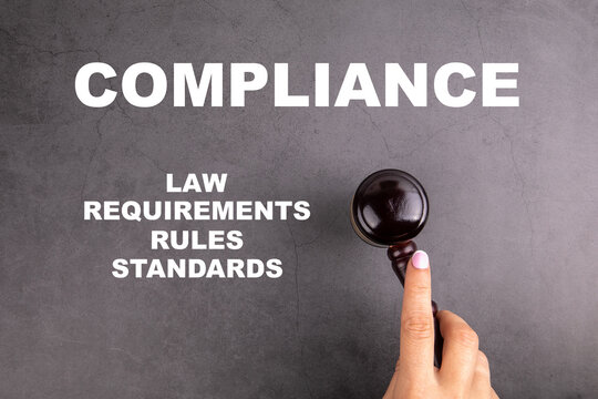 COMPLIANCE. Law, Requirements, Rules and Standards concept. Court hammer in woman's hand
