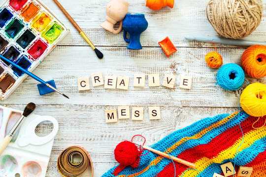 """Wooden letters form the phrase """"Creative mess."""""""