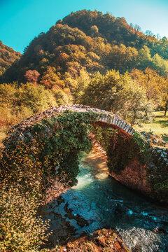 The picturesque old Besletsky bridge (or the bridge of Queen Tamara) in autumn.