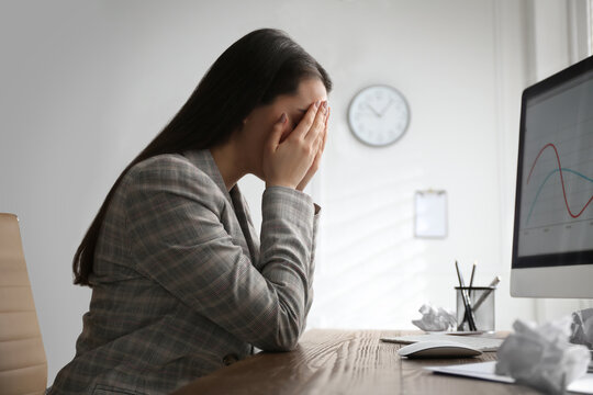 Businesswoman stressing out at workplace in office