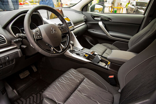 MOSCOW, RUSSIA - SEPTEMBER 30, 2019: Empty interior of new SUV car Mitsubishi Eclipse Cross. driver's seat and steering wheel