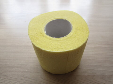 a roll of yellow tissue paper