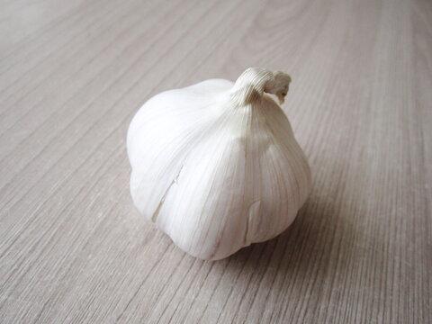 Fresh head of garlic on table surface