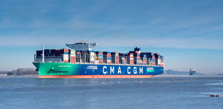 The LNG-powered containership, the CMA CGM Louvre, on the river Elbe near the city of Hamburg, Germany. Ship is leaving the port of Hamburg on Sunday the 14th of February 2021.