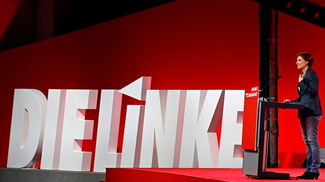 """Co-leader of the left wing """"Die Linke"""" (The Left) party Katja Kipping stands next to the party's logo as she speaks on stage during the party congress in Berlin"""