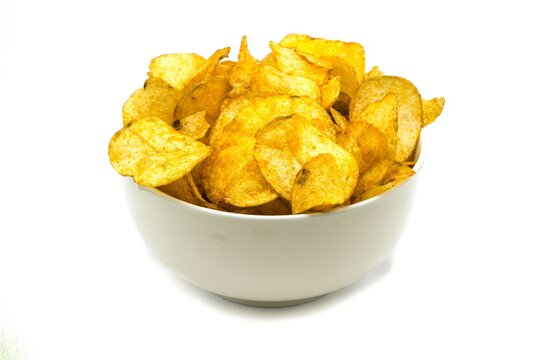 Potato chips in bowl isolated on white background