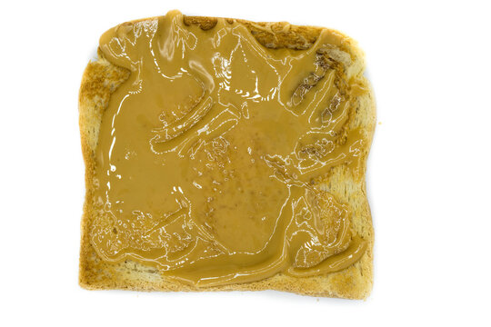 Toasted bread with peanut butter isolated on white background top view