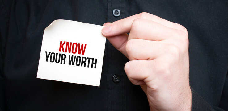 Businessman holding a card with text Know Your Worth,business concept