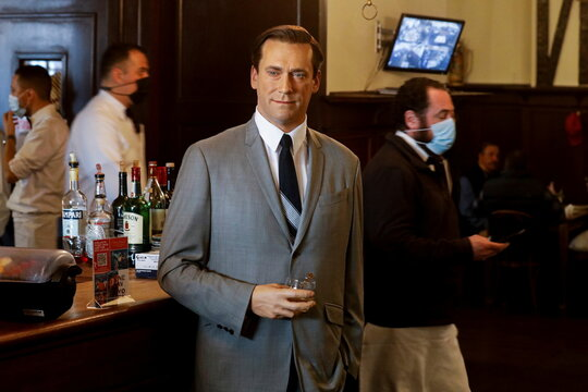 Madame Tussauds's wax figure of Jon Hamm stands at the bar at Peter Luger Steak House in Brooklyn, New York