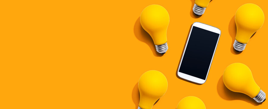 Smartphone with yellow light bulbs from above