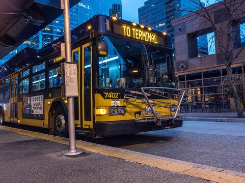 Bellevue, WA / USA - circa December 2019: Bellevue Metro Transit Bus at the transit center downtown at night.