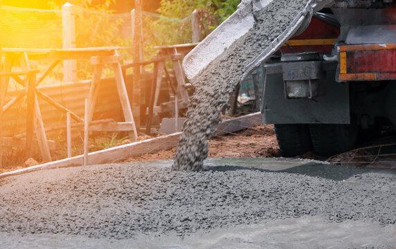 pouring a concrete mix at road construction site
