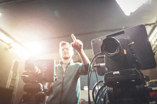 Cameraman operates a film camera, broadcasting recording studio