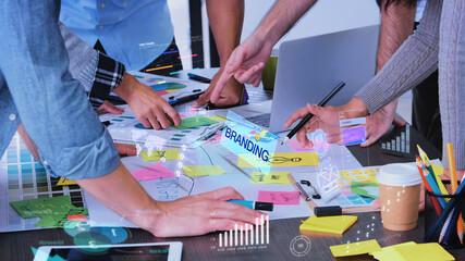 Obraz Close up creative designer use augmented reality app brainstorming about branding on desk at modern office.Creative digital development agency - fototapety do salonu