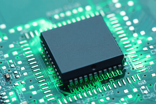 Backlit green printed circuit board with the chip processor, background technology