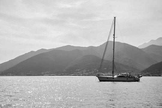 Sail yacht with tall mast in the sea