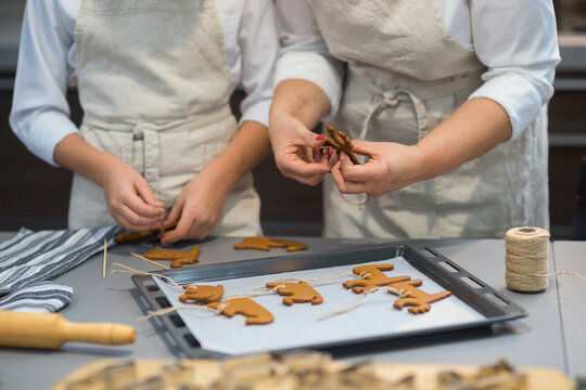 the process of making gingerbread. baking holiday cookies at home. cookies of different shapes on a baking sheet