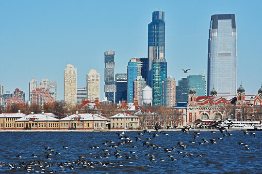 Ellis Island and Lower Manhattan skyline, New York City seen from Liberty State Park, New Jersey.