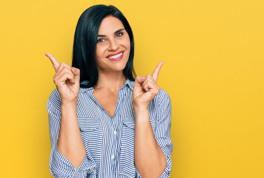 Young caucasian woman wearing casual clothes smiling confident pointing with fingers to different directions. copy space for advertisement