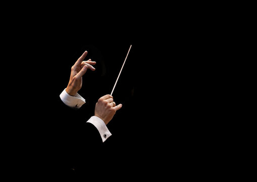 Conductor's hands on a black background