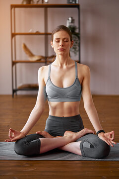 Beautiful young woman practicing yoga in the lotus position