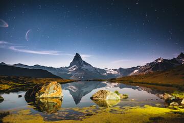 Wall Mural - Famous peak Matterhorn (Cervino) under the starry sky. Location place Stellisee, Switzerland, Swiss alps, Europe.