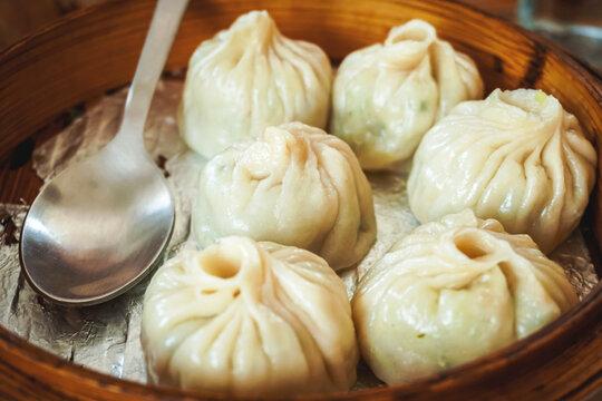 steamed dumplings in wooden basket