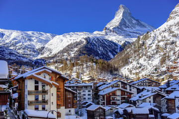 City of Zermatt in swiss alps in winter. In the backgroung the famous peak Metterhorn.