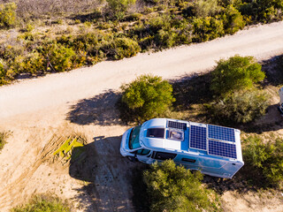 Fototapeta Caravans with solar panels on roof camping on nature.