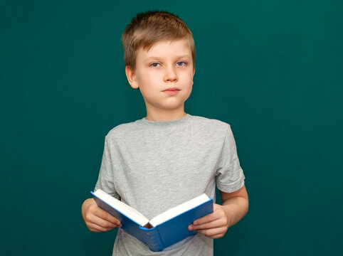 Boy child with an open book in his hands