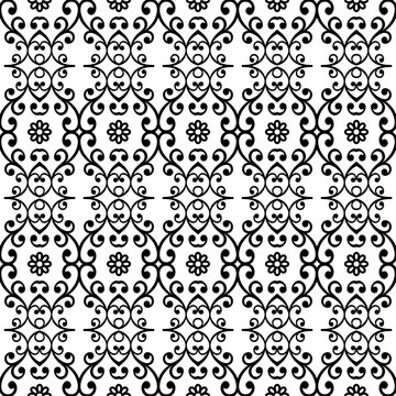 Floral ornament. Seamless abstract classic background with flowers. Pattern with repeating floral elements. Black and white ornament for fabric, wallpaper and packaging