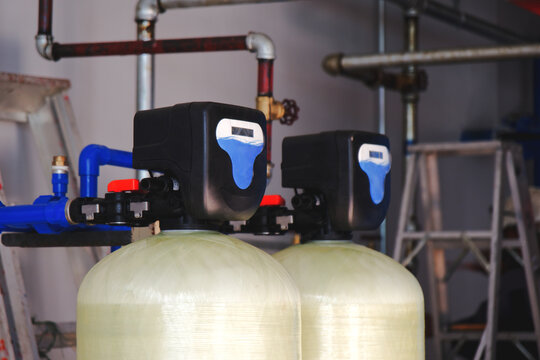 Install a water softener tank system inside the building.