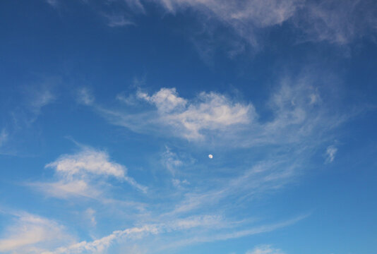 Nice sky with little moon and some small clouds