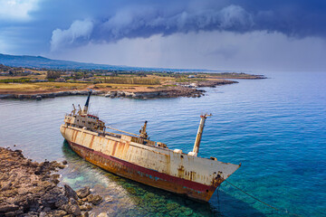 Cyprus. Shipwreck. The ship ran aground top view. The boat crashed on the coastal rocks. Abandoned boat. Ship's aground. View from the drone. White stones of the Mediterranean coast
