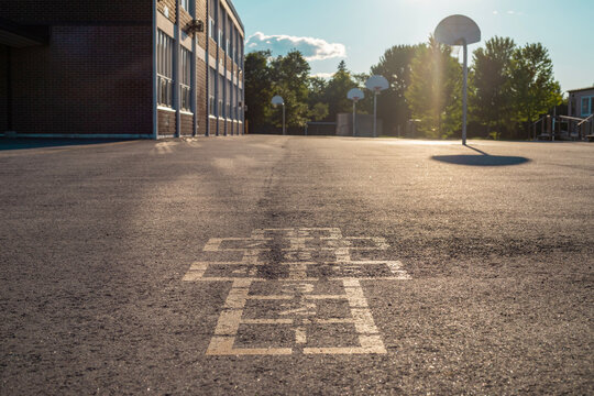 School building and school yard in the evening
