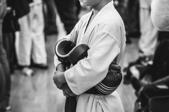 Martial Arts - Taekwondo. Athletes in a white uniform with gloves before the fight. Retro style with grain for film photography.