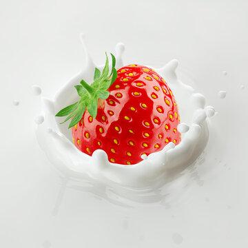 Strawberry with Milk splash on white background