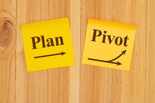 Making a pivot in your business plan on two yellow sticky note paper