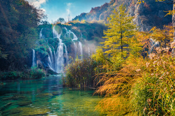 Landscape photography. Sunny morning view of pure water waterfall in Plitvice National Park. Picturesque autumn scene of Croatia, Europe. Abandoned places of Plitvice lakes series.