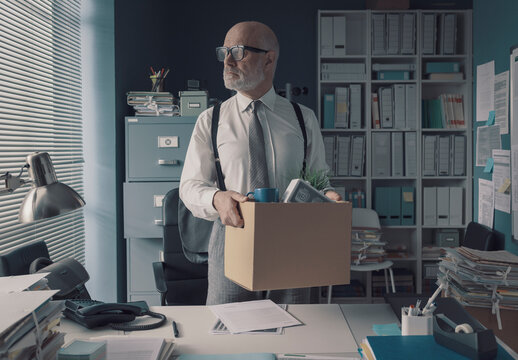 Businessman packing and leaving the office